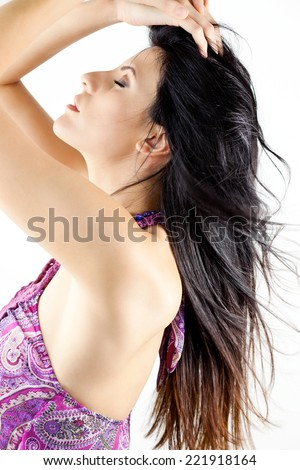 close up picture of a young beautiful woman with hands in her hair. Profile - stock photo