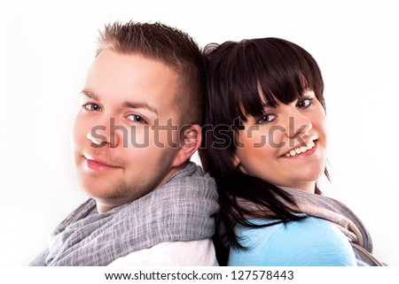 Close-up picture of a young couple smiling at the camera. Isolated on white