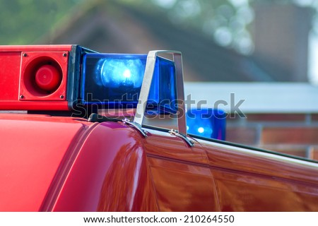 close-up picture of blue lights and sirens on a fire-truck - stock photo