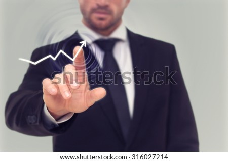 Close-up picture of businessman's finger drawing an activity diagram on the screen. Bearded man showing the growth of profit in the company. - stock photo