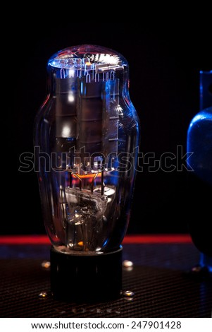 Close up picture of electronic vacuum tube of a hi fi amplifier , black  background - stock photo