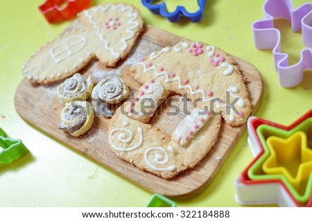 Close up picture of gingerbread cookies on wooden desk background copy space - stock photo