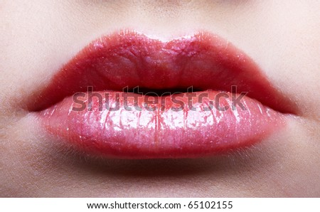 Close-up picture of lips of young woman - stock photo
