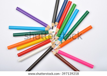Close up picture of many little colored pencil crayons on white background. Assortment of sharpened colored pencils/ Colored drawing pencils. Selective focus - stock photo