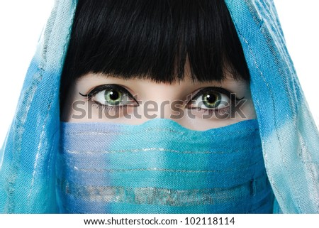 Close up picture of  woman wearing a veil on a white background.