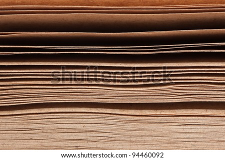 Close-up picture showing stack of brown papers