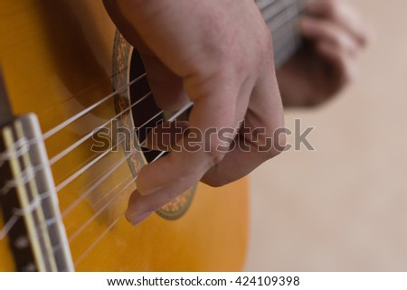 Close up picture with musician playing guitar - stock photo