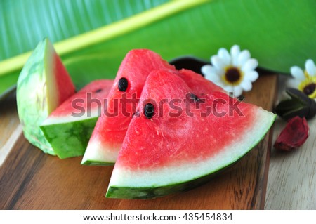 Close up pieces of fresh watermelon on wooden board - stock photo