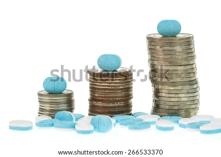 Close up pile of medicine and coin stack  isolated on white background - stock photo