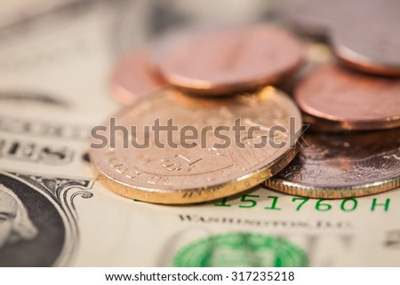 Close up pile of money, american cent coins on dollar notes - stock photo