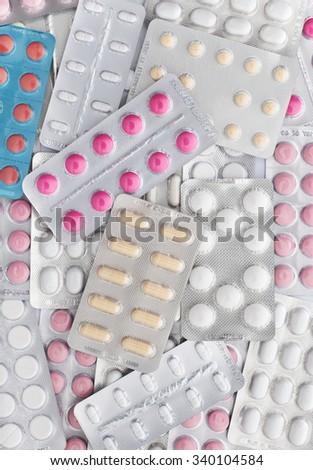 Close up Pile of pills in blister packs , full frame - stock photo