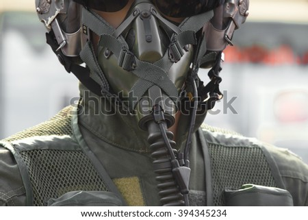 Close-up pilot wearing mask and helmet. - stock photo