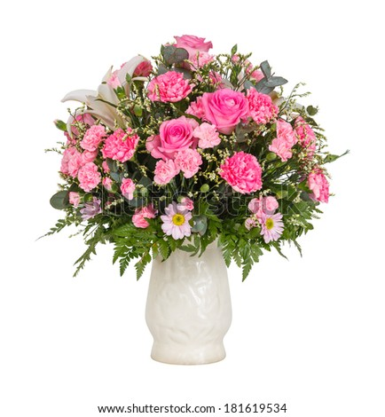 Close up pink color carnation roses chrysanthemum lily flower bouquet in glass vase isolated on white - stock photo