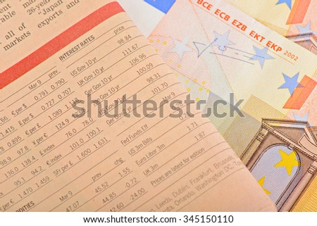 Close-up pink newspaper with of Euro banknotes  on the table - stock photo