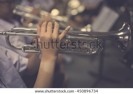 Close up Pipes in the hands of young trumpet player - stock photo
