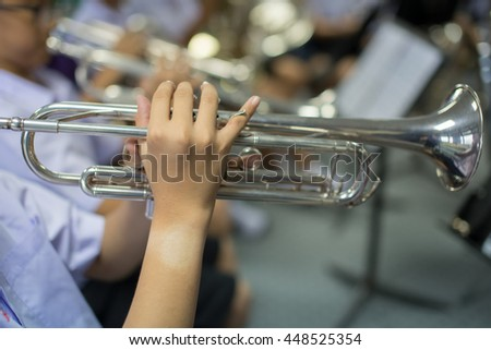 Close up Pipes in the hands of young trumpet player,music concept,music background - stock photo