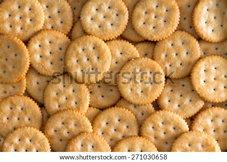 Close up Plenty Salted Toasted Round Crackers for Backgrounds, Captured in High Angle View. - stock photo