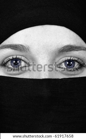 Close-up portrait a woman with black vell, arabic style - stock photo