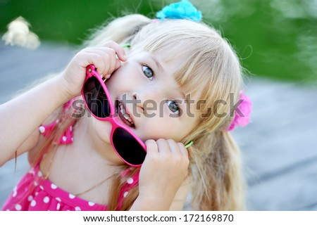 close up portrait adorable smiling girl with sunglasses - stock photo