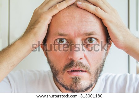Close up portrait bearded and mustache man, shocked expression  - stock photo