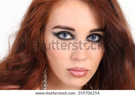 Close-up portrait beautiful young girl with red hair and with blue eyes