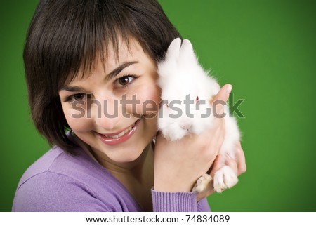 close up portrait girl holding rabbit on hand