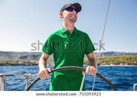 Close up portrait happy man on yacht, man in sunglasses.strong man laugh,attractive,guy,hipster boy,yachting,summer holidays,emotional portrait man in sea,tan,green t-shirt,casual wear