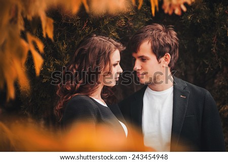Close-up portrait happy pretty young couple in love outdoors in autumn day