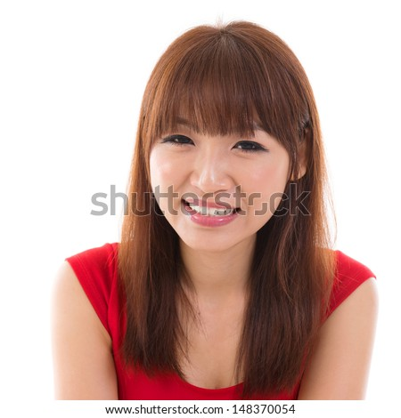 Close up portrait headshot of Asian woman smiling wearing red dress isolated on white background. Asian female model. - stock photo