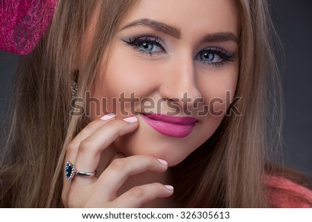 Close-up portrait, isolated, Blonde model looks like Barbie with pink lips and blue eyes