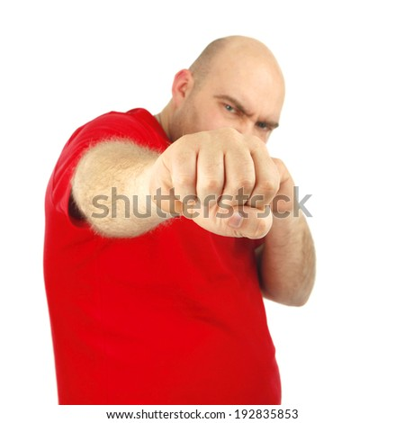 Close up portrait of a aggressive man showing his fist. Isolated Background