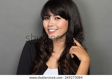 close up portrait of a asian businesswoman smile - stock photo