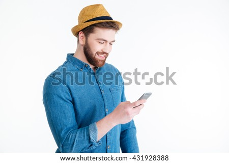 Close-up portrait of a attractive hipster man texting message using mobile phone isolated on the white background - stock photo