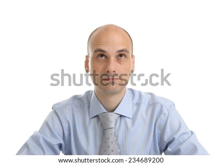 close up portrait of a bald businessman looking up - stock photo
