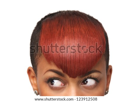 Close up portrait of a beautiful african american girl's urban haircut and eyes. She is looking away. Isolated on white background - stock photo