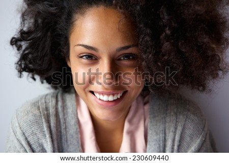 Close up portrait of a beautiful african american woman face smiling - stock photo