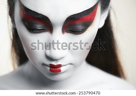 Close-up portrait of a beautiful asian woman on white - stock photo