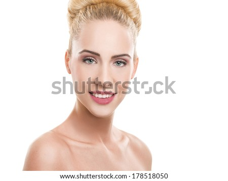 Close-up portrait of a beautiful blond woman looking at camera.