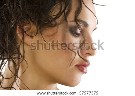 close up portrait of a beautiful brunette with wet hair and creative hair style - stock photo