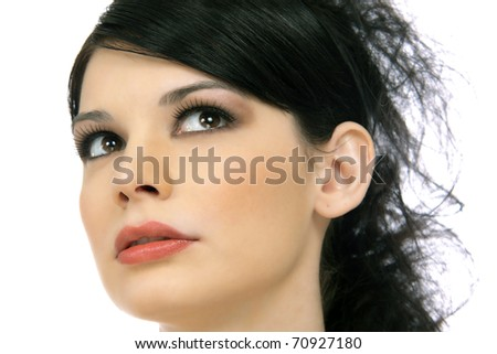 Close-up Portrait of a Beautiful Brunette Young Woman's Face - stock photo