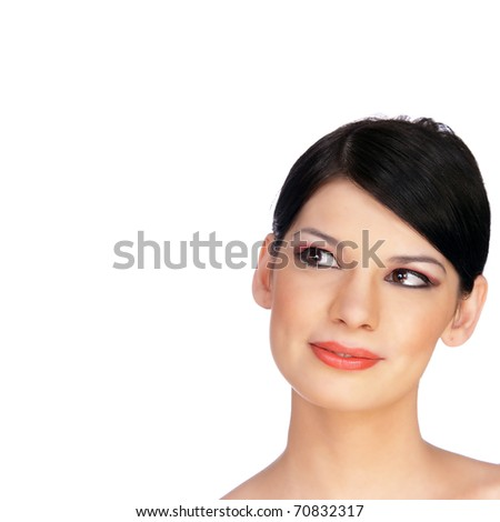 Close-up Portrait of a Beautiful Brunette Young Woman's Face Smiling. Copy-space and room for text on this isolated - stock photo