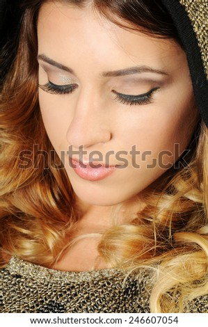 close up portrait of a beautiful caucasian girl with perfect evening make up and long lashes looking down  - stock photo