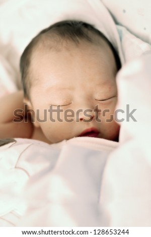 close-up portrait of a beautiful Chinese sleeping baby - stock photo