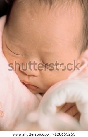 close-up portrait of a beautiful Chinese sleeping baby