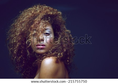 Close up portrait of a beautiful female fashion model with curly hair - stock photo
