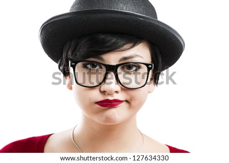 Close-up portrait of a beautiful girl bored with something, wearing a hat and nerd glasses - stock photo