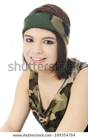 Close-up portrait of a beautiful girl in a camouflage headband and sleeveless shirt.  On a white background.