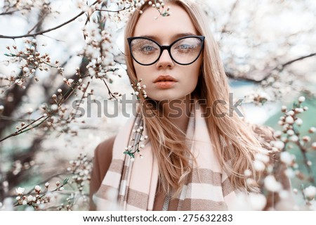 Close-up portrait of a beautiful girl in fashionable colors