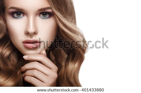 Close-up portrait of a beautiful girl with curly hair, a hand touched his chin. Beauty Girl. Looking at camera. Isolated on white background. Copyspace. - stock photo