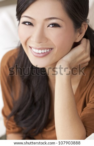 Close up portrait of a beautiful happy young Chinese Asian Oriental woman or girl - stock photo